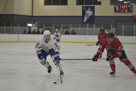 Boys hockey wins season opener with ease