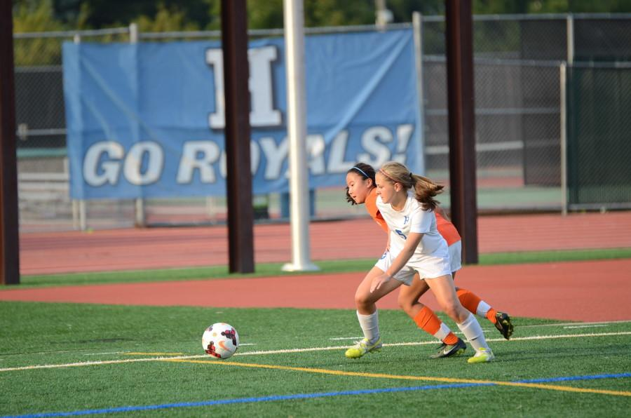 Ashley Akin, senior, fights for the ball.