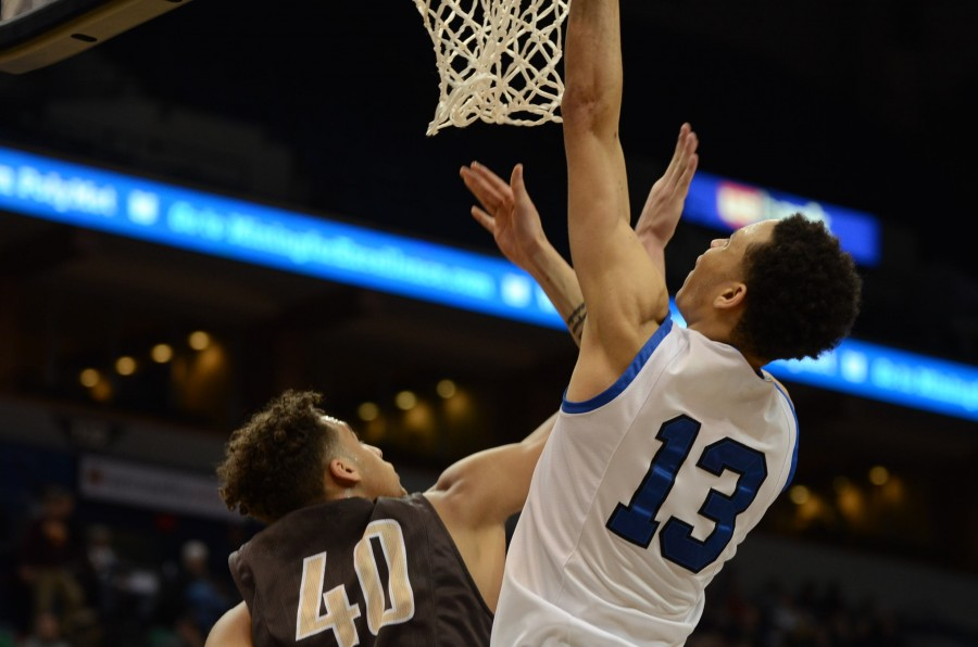Amir Coffey, senior, goes in for a layup in the semifinal state game against Apple Valley.