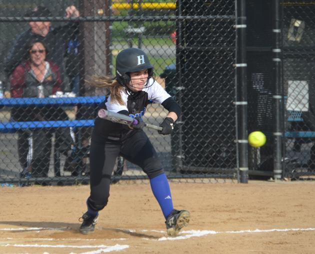 Hannah Kleist, junior, bunts her way on to base last season against St. Louis Park