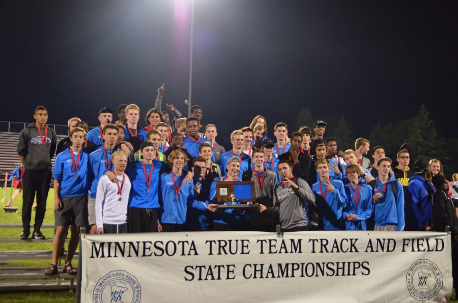 The Hopkins boys track track team poses for photos with their trophy. They took second place at the True Team State meet.