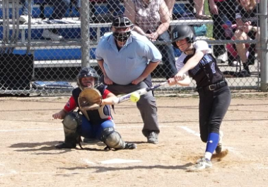 Natalie DenHartog, sophomore, swings at pitch in the strike zone