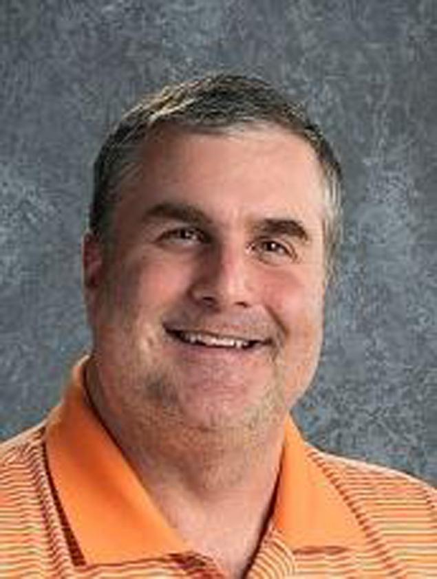 Mr. Greg Bartz, math teacher, is resigning from his swim coaching job