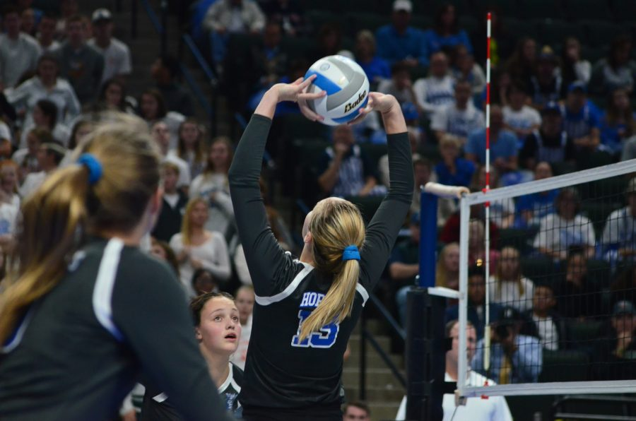 Tara Lee, senior, sets the ball during the first volleyball state game against Moorhead last year.