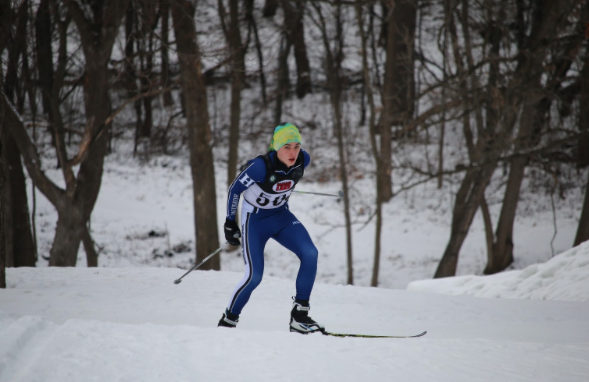 Logan Hoffman, junior, skis through meet. This picture was taken at the conference meet.