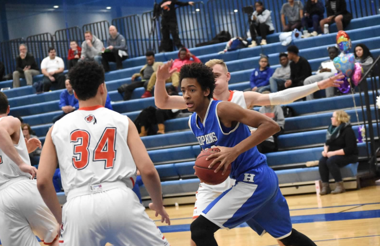 Zeke Njaji, sophomore, grabs basketball and looks to put it back up. The Royals beat the Warriors 87-73.