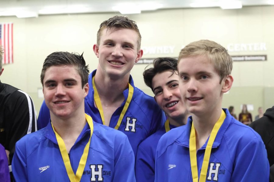 The 200 medley relay of David Lorentz, junior, Avery Martens-Goldman, junior, Elliot Berman, NJH eighth grader, and Avi Bundt, junior, receives their fourth-place medals at the section 6AA meet.