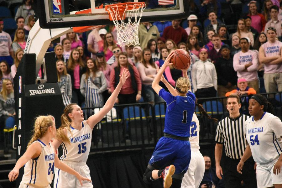 Paige Bueckers, freshman, shoots a layup in the AAAA state quarterfinal game against Minnetonka on March 14. Bueckers scored a season high of 31 points in the quarterfinal game.