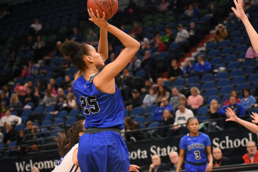 Angie+Hammond%2C+senior%2C+makes+a+basket+during+the+state+quarterfinal+game.+