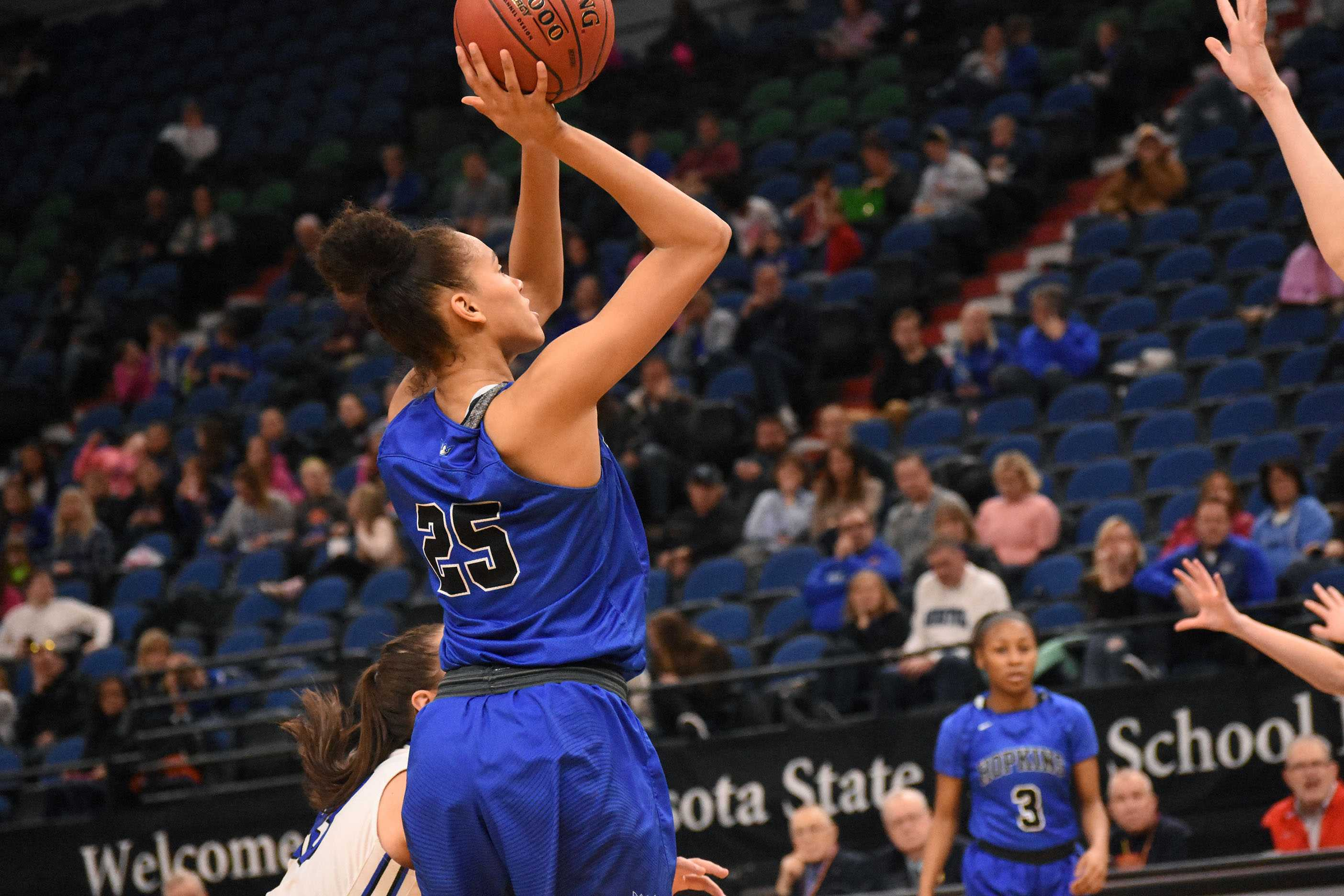 Angie Hammond, senior, makes a basket during the state quarterfinal game.