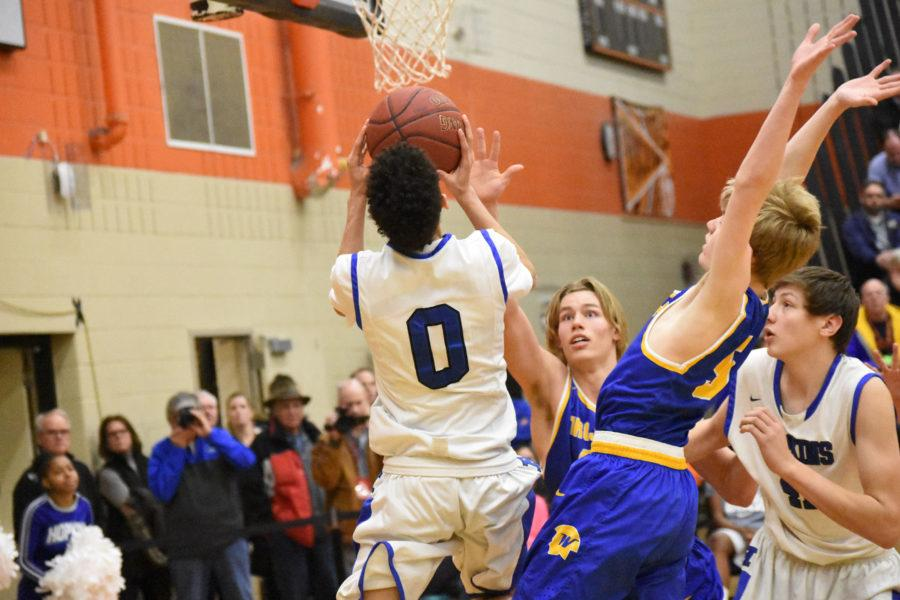 Blaise Beauchamp, freshman, attacks the hoop in Section finals loss to Wayzata.