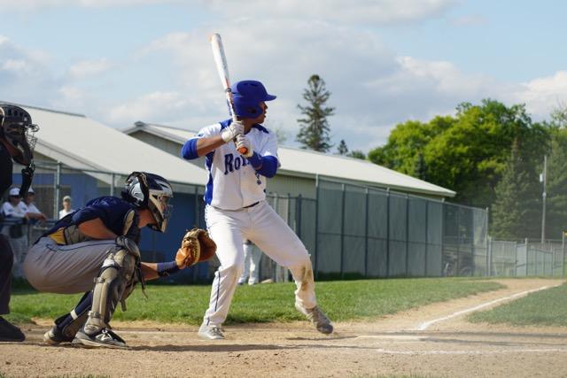 Morgan Holmes, senior, steps up to the plate preparing to take an at-bat.