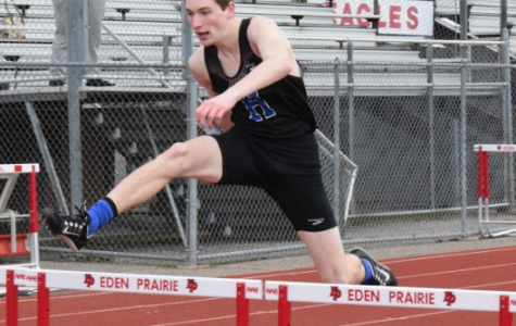 Joe Swenson,senior, runs the hurdles at meet last year.
