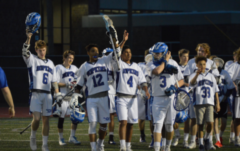 Royals boys lacrosse waive helmets after winning game last year.