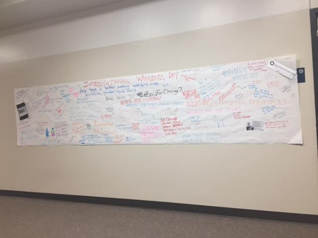 On March 8, students signed posters outside the classroom of Ms. Maggie Temple, Social Studies, with encouraging and empowering messages in recognition of International Women's Day.