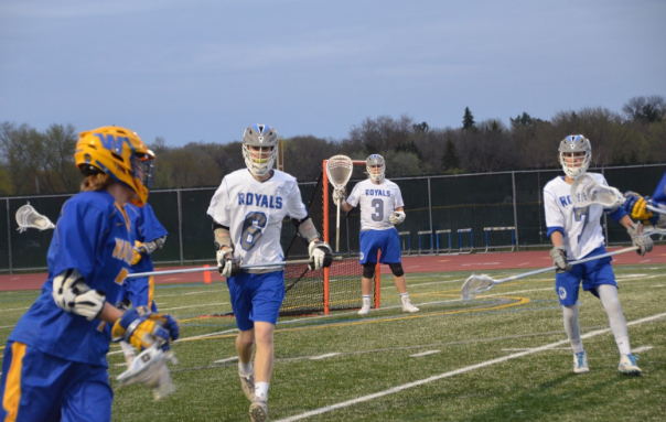 Royals defend zone during game against Wayzata. The Royals were defeated by the Trojans 3-23.