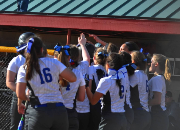Royals+softball+meets+Parker+Stoddard%2C+sophomore+as+she+hits+a+homerun.+The+Royals+beat+the+Crimson+5-0.