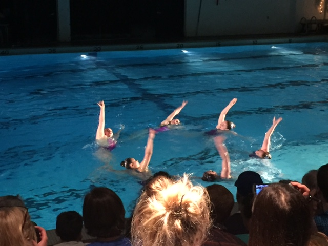The extended division routine of Kristen Ho and Alyssa Peck, juniors, Lola Brown, sophomore, and Maggie Cleary and Sophie Dirnberger, seniors, performs their Britney Spears-inspired routine at the synchro show on May 12.