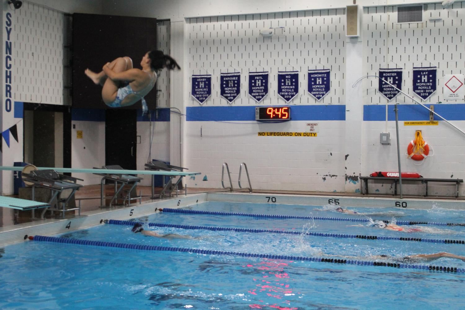 Yasmin Nachmias, freshman, performs a back somersault dive during practice on Sept. 13.