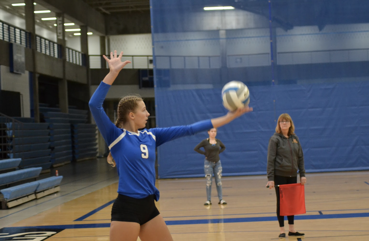Ana Erickson, junior, prepares to serve. The Royals fell the the Minnetonka Skippers in four sets yesterday, September 19th.