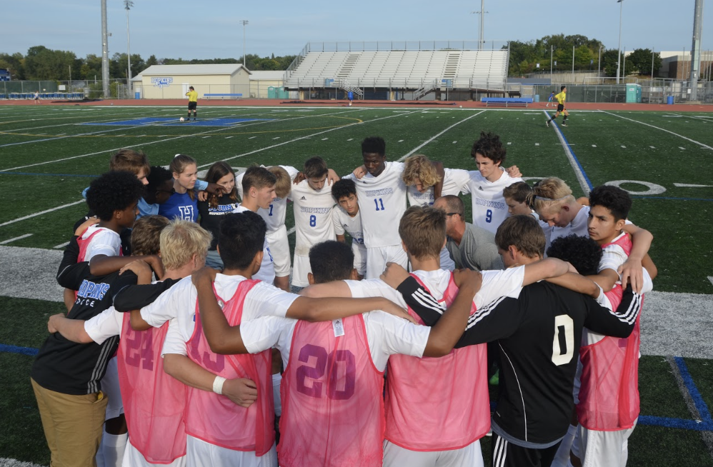 Royals+boys+soccer+huddles+up+before+game.+