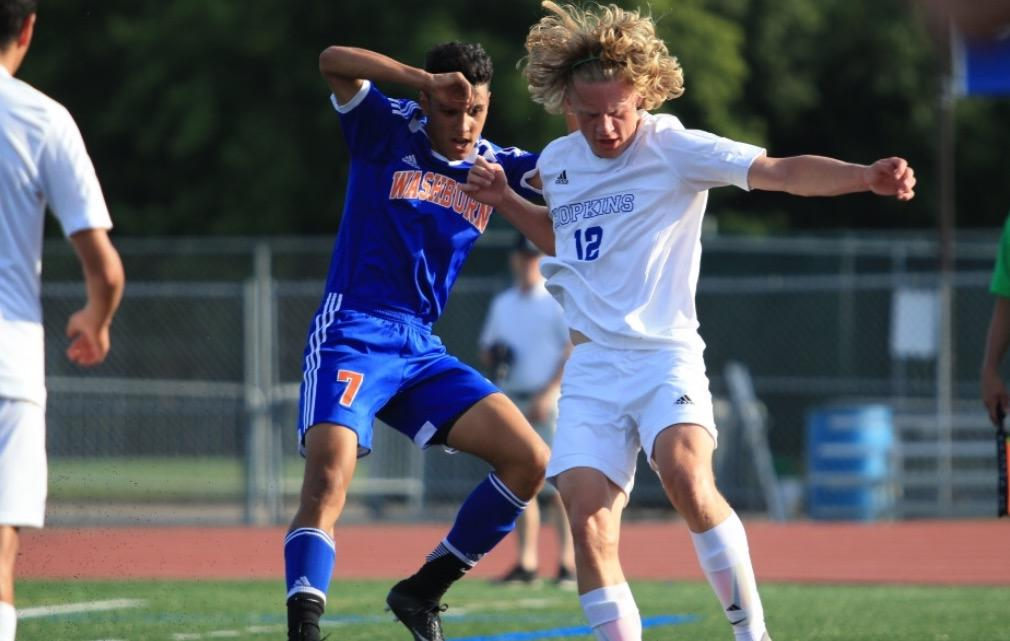 Ben Paschke, junior, battles with Washburn forward. The Royals lost to the Millers 2-3.