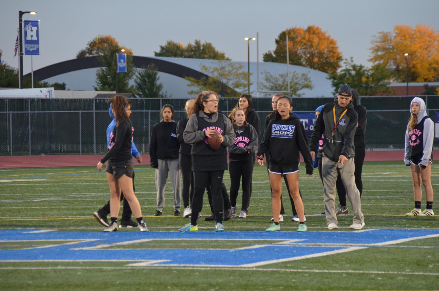 Senior ladies warm up at Powder Puff. The Seniors won 12-0.