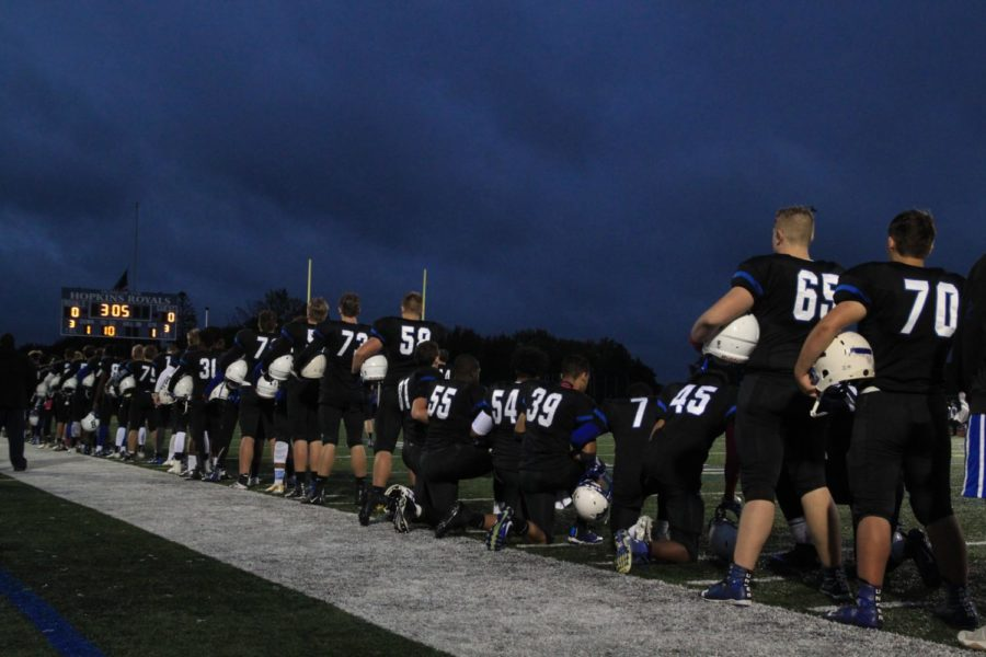 Some+football+players+joined+together+and+knelt+during+the+National+Anthem.+The+Royals+won+this+game+21-19.+