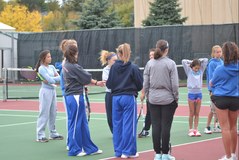 Girls tennis huddles up to discuss practice plans.