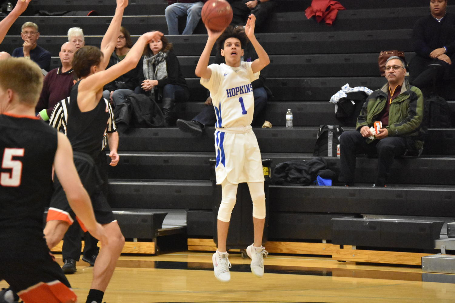 Blaise Beauchamp, sophomore, shoots three from corner. The Royals beat the Orioles 98-70.