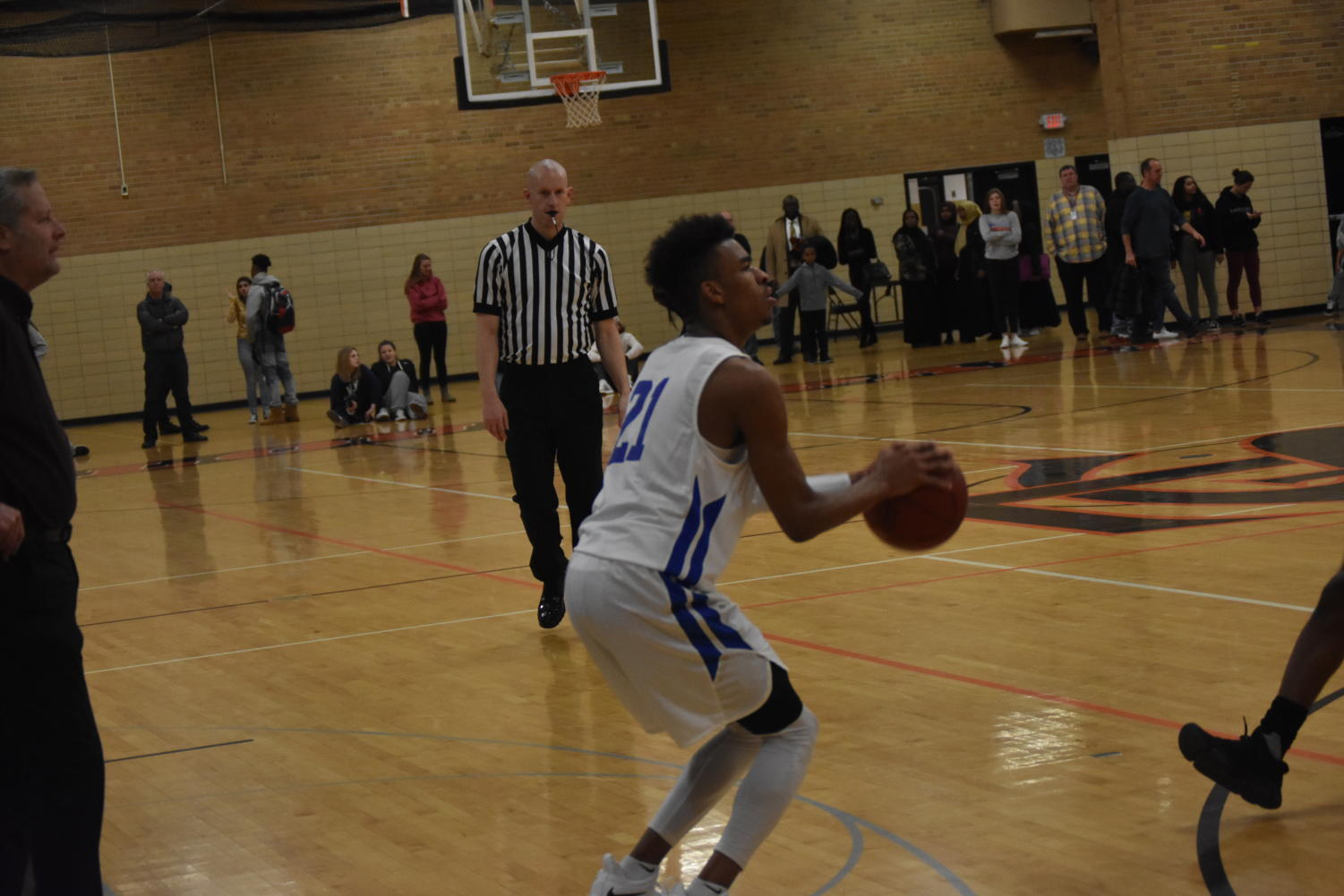 Anthony Davis, senior, pulls up for three pointer against Orioles.