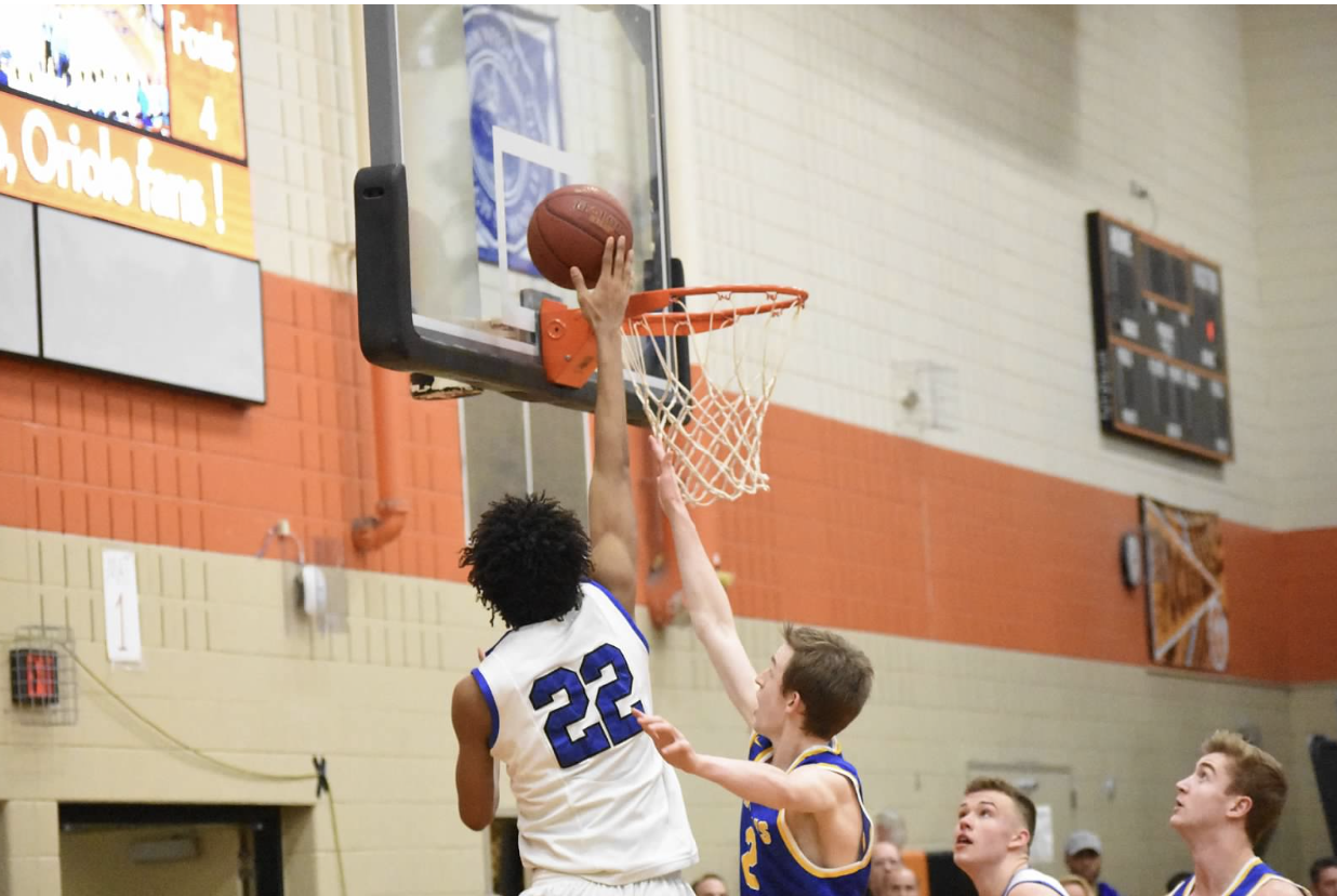 Zeke Nnaji, junior, goes up for a contested lay-up against Wayzata in the Sections finals. Hopkins lost this game. The Royals lost 66-51 and ended their season.