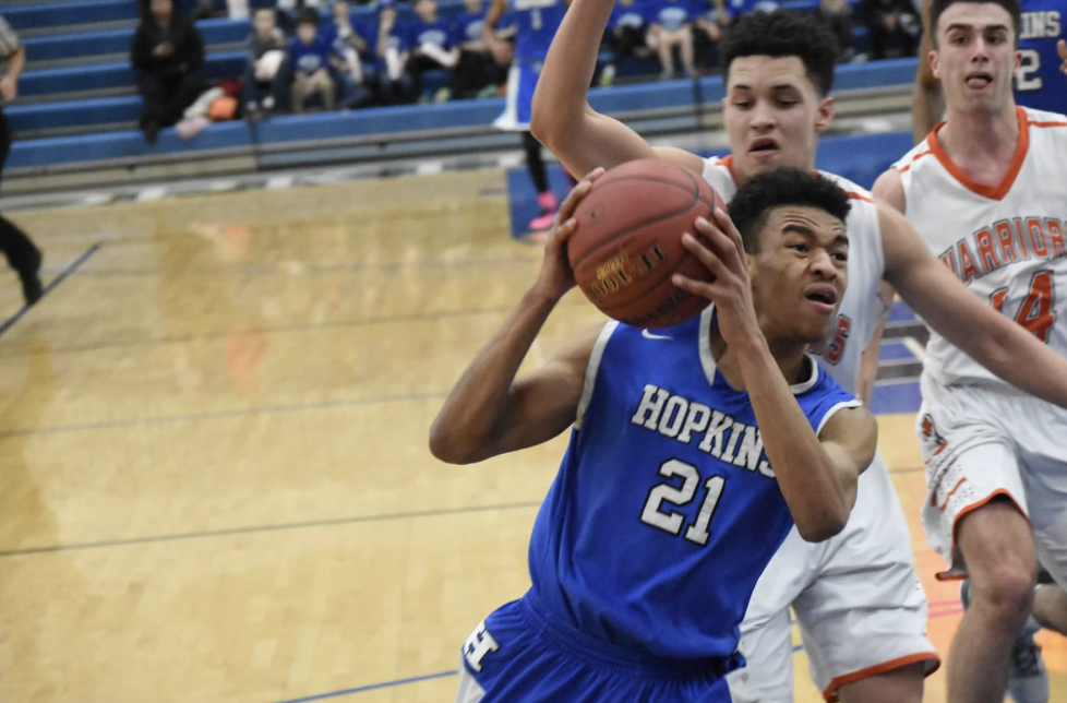 Anthony Davis, senior, drives hard at the hoop for boys' basketball team. The Royals season kicked off last Saturday against the Cretin-Derham Hall Raiders.