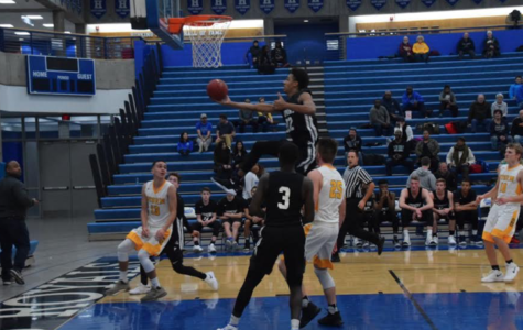 Boys basketball comes back from behind and beats the Islanders