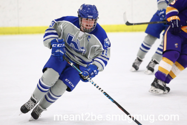 Johnny Kahner, senior, captain, skates ups ice and looks for pass from teammate.