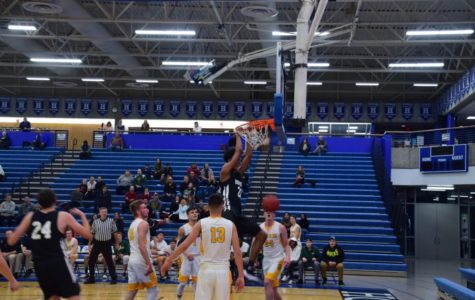 Zeke Nnaji, junior, goes up for two handed dunk. Royals beat the Storm 95-53.