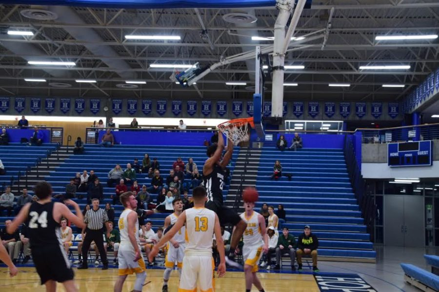Boys basketball takes down Sauk Rapids for first win of the season