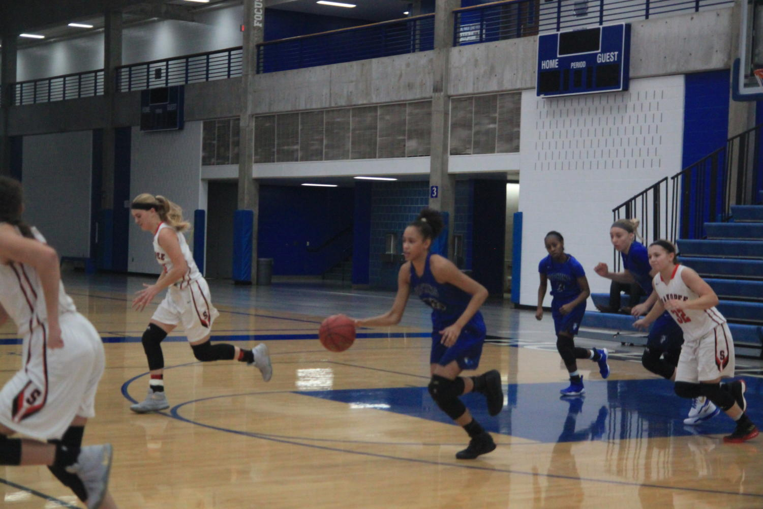 Angie Hammond, senior, dribbles up the court.