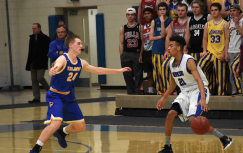 Anthony Davis, senior, dribbles in front of Wayzata defender last year. The Royals look to beat the Trojans after losing to them last year in the section finals.