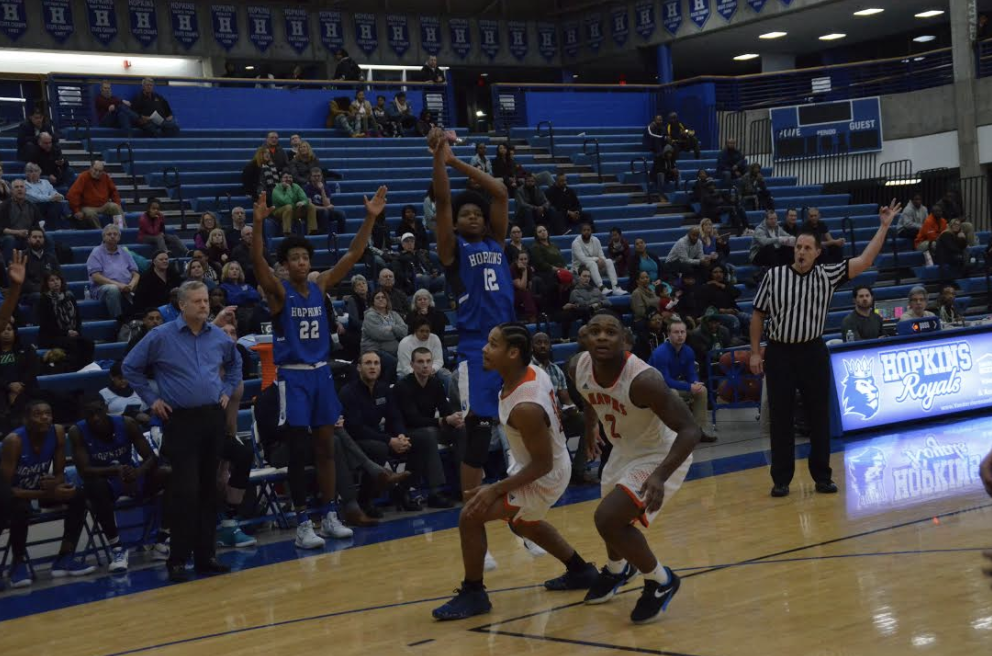 Kerwin Walton, junior, pulls up for a 3-point shot. The Royals open up the season against top-ranked East Ridge.