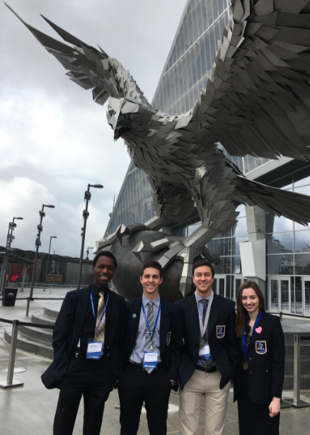Four+students+from+Hopkins+DECA+standing+outside+of+the+Mercedes+Benz+stadium+in+Atlanta%2C+GA+for+Nationals.+