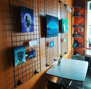 Junior provides art at local coffee shop in Downtown Hopkins