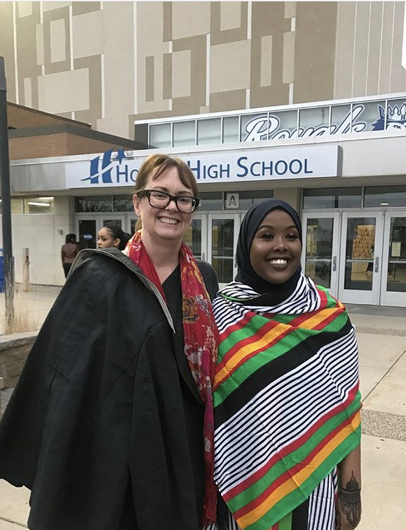 Ms. Heimlich, social studies and Salma Said, junior, pose for a picture outside HHS on Somali night. Somali night was an AVID service project.
