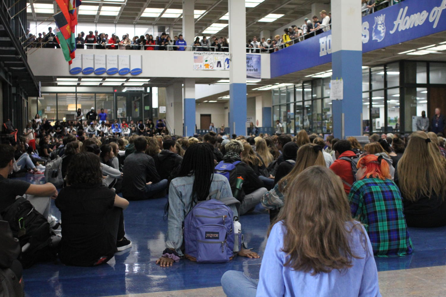 HHS students sitting in the mall holding a moment of silence for sexual assault victims.