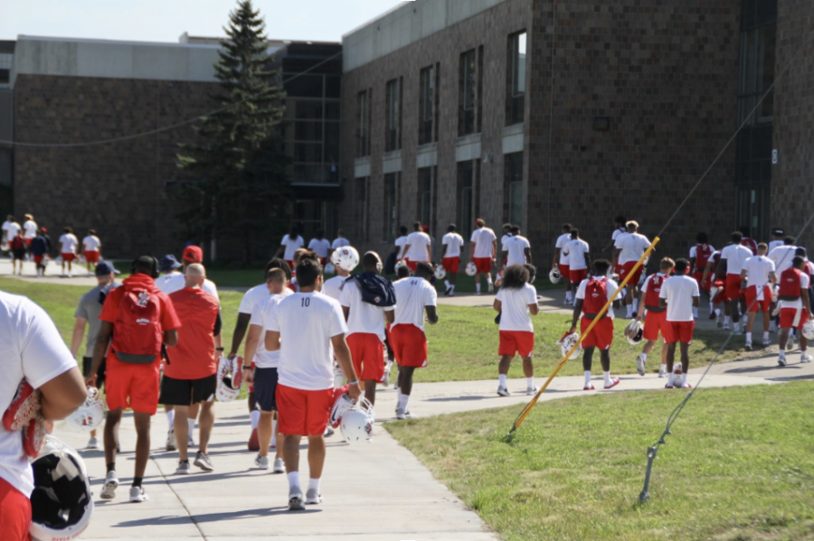 The Fresno State football team walks towards the HHS stadium. They take on the Gophers tomorrow.