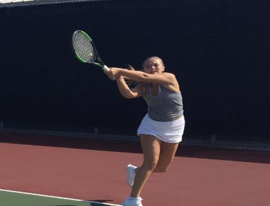Mary Murphy, junior, returns a backhand. Murphy is a part of the Girls varsity tennis team.