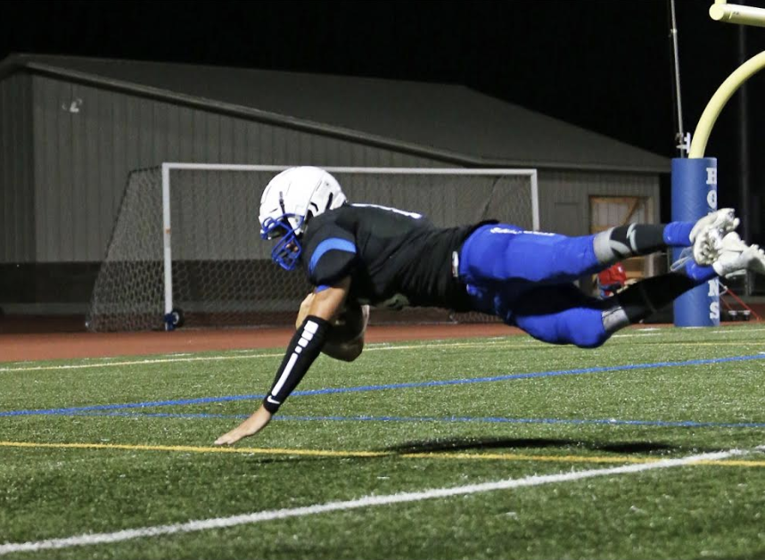 James Klecker, senior, dives into the end zone. The Royals play Forest Lake this Friday