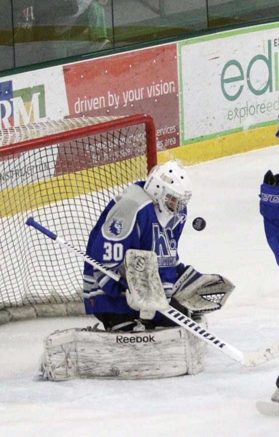 Ethan Myers, senior, stopping a shot in a game earlier in the season. Myers has primarily been a goalie in his career.