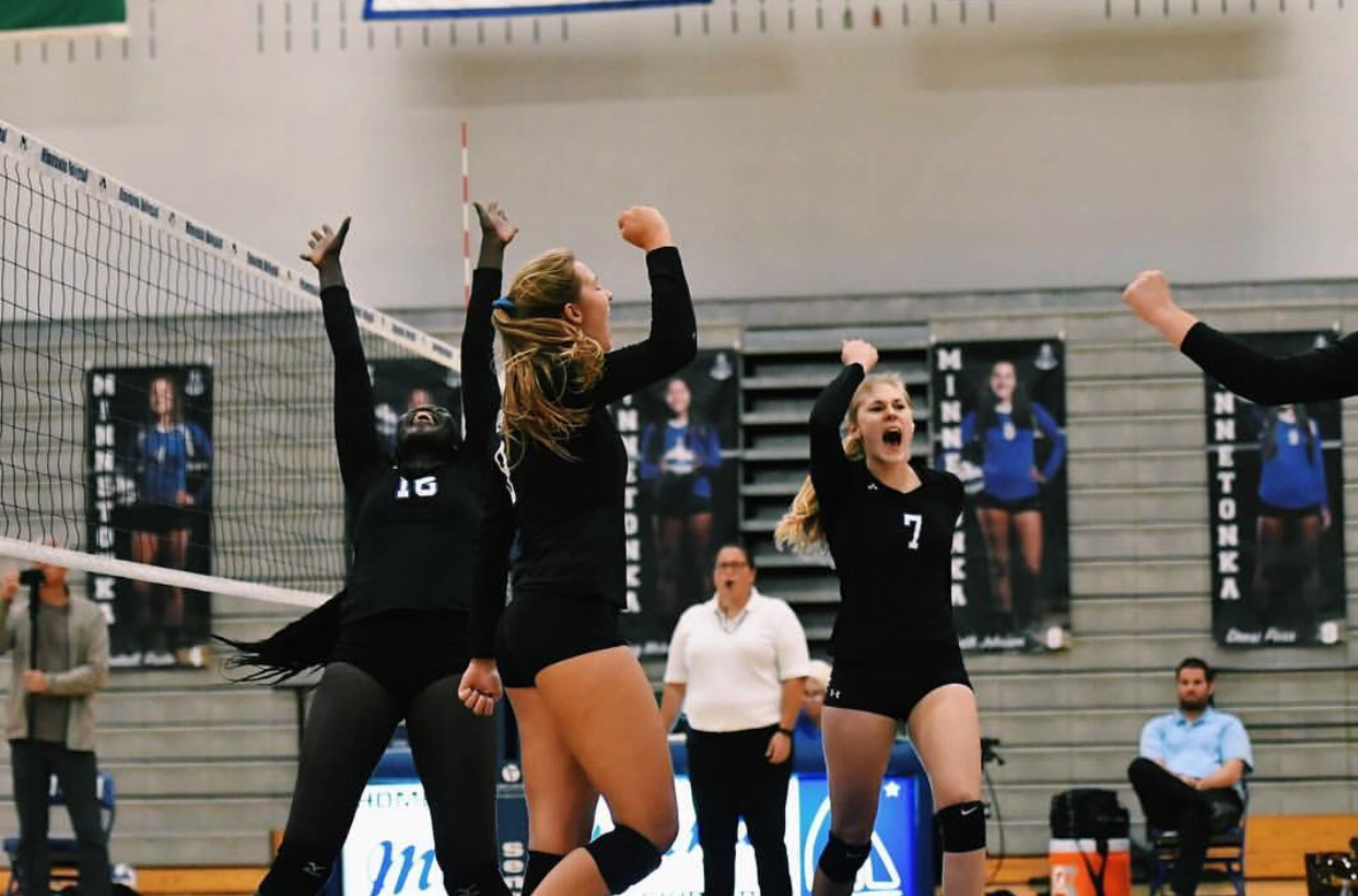 Anna Erickson, senior, celebrates a point with her team. Erickson is committed to Central Michigan?