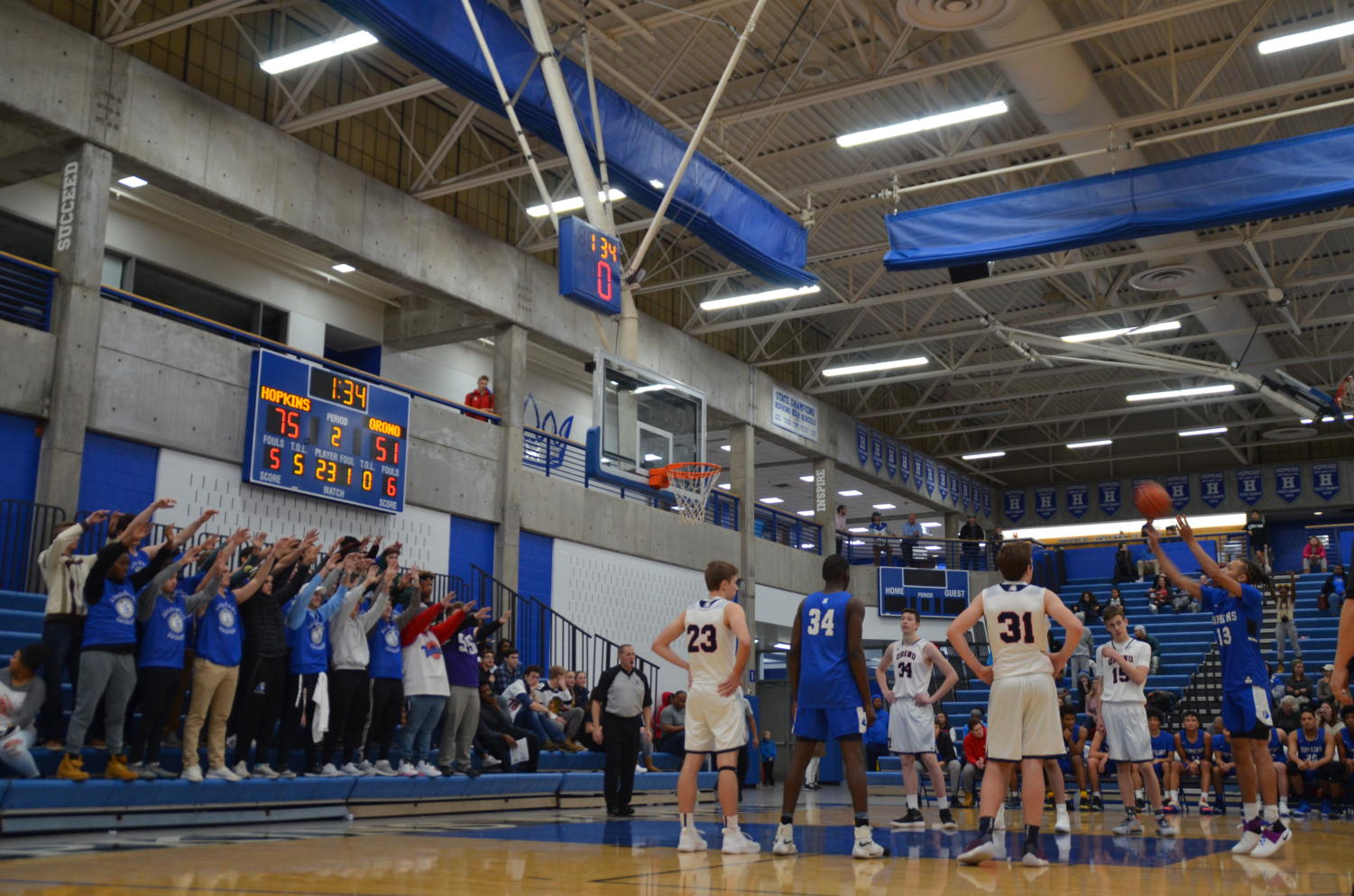 Rayquan Valentin, senior, shoots a free throw in the win against Orono. Valentin hit multiple three pointers in the game.